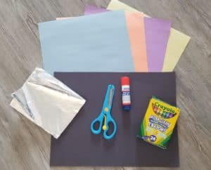 easy space crafts supplies of construction paper, aluminum foil, scissors, glue and crayons
