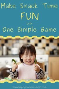 toddler happily playing a mystery food game