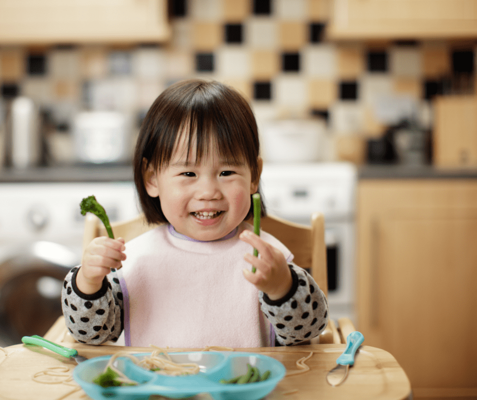 happy toddler eating food