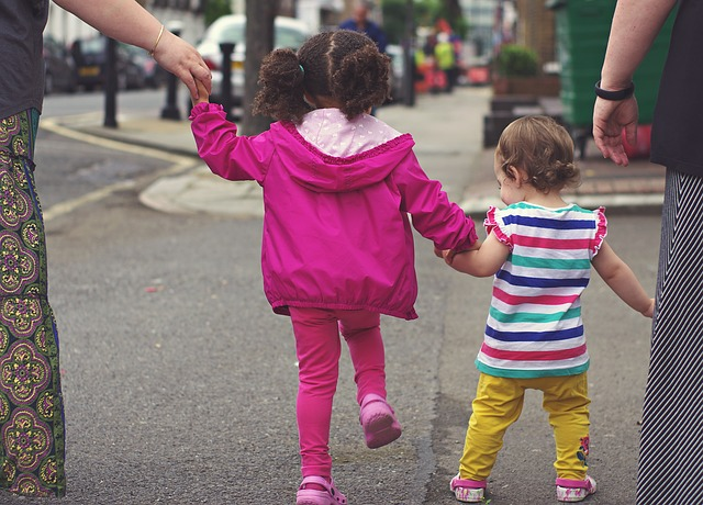 toddlers and moms on neighbourhood walk