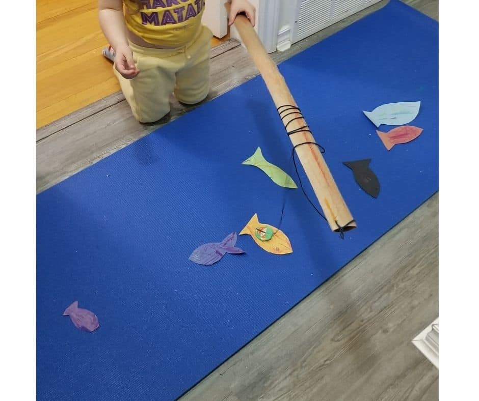 toddler fishing game with blue mat pond