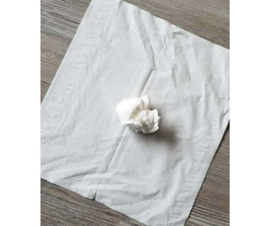 one tissue ball on top of tissue lying flat